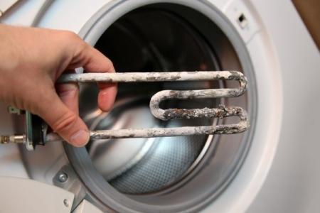 налет от жесткой воды на нагревательном элементе стиральной машины
